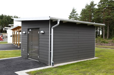 Shed with grey façade panels